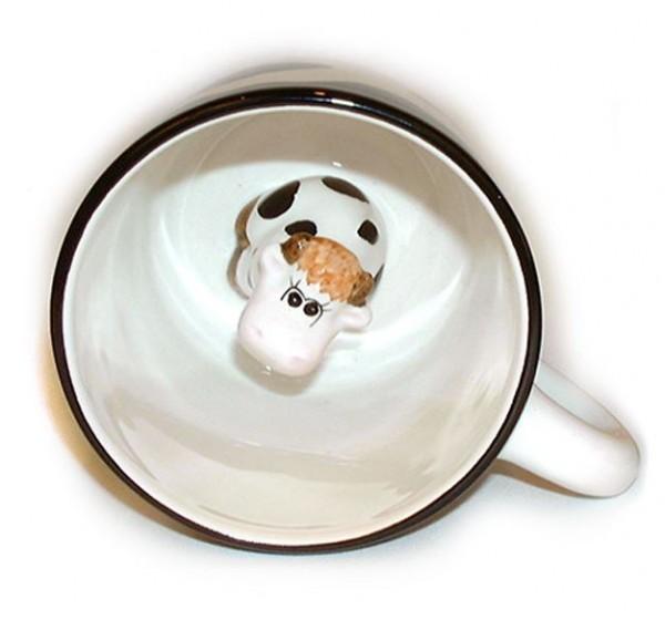 Tasse mit kleiner Kuh innen